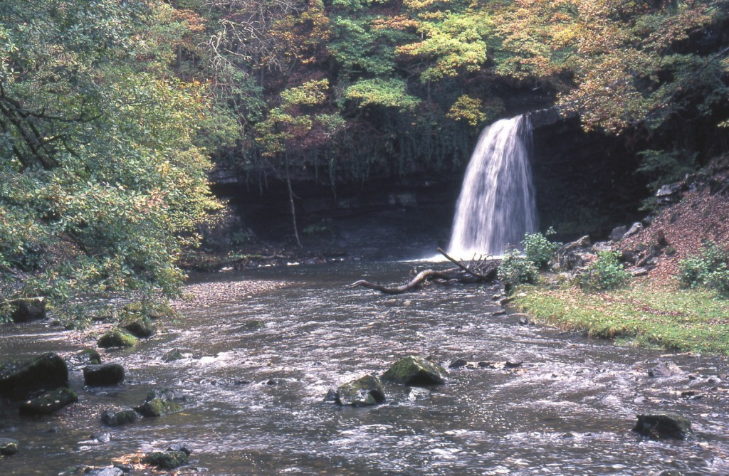 """Neath Waterfall"". Licensed under Public Domain via Wikimedia Commons - http://commons.wikimedia.org/wiki/File:Neath_Waterfall.jpg#/media/File:Neath_Waterfall.jpg"