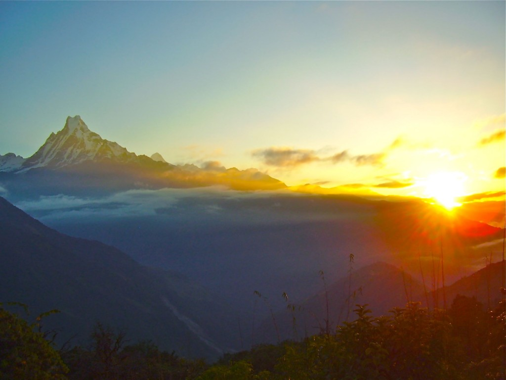 The view from Poon Hill in the Himalayas at sunrise.