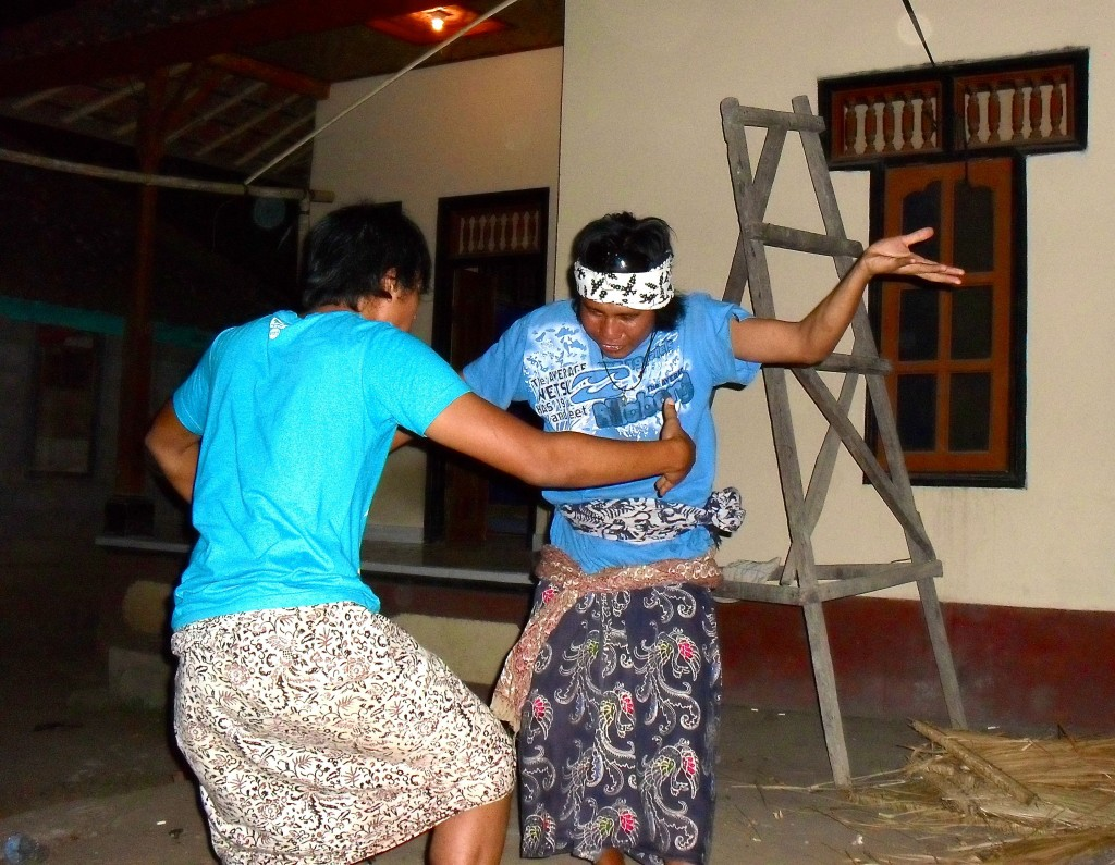 Men dancing in Amed, Bali.